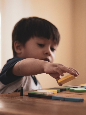 boy playing blocks